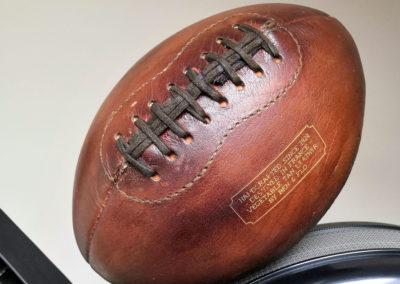 Ballon de foot US sur un rameur